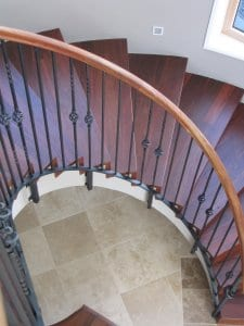 Timber stair with wrought iron balustrade