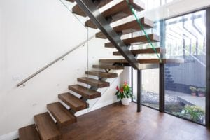 Floating Steel stair with glass balustrade