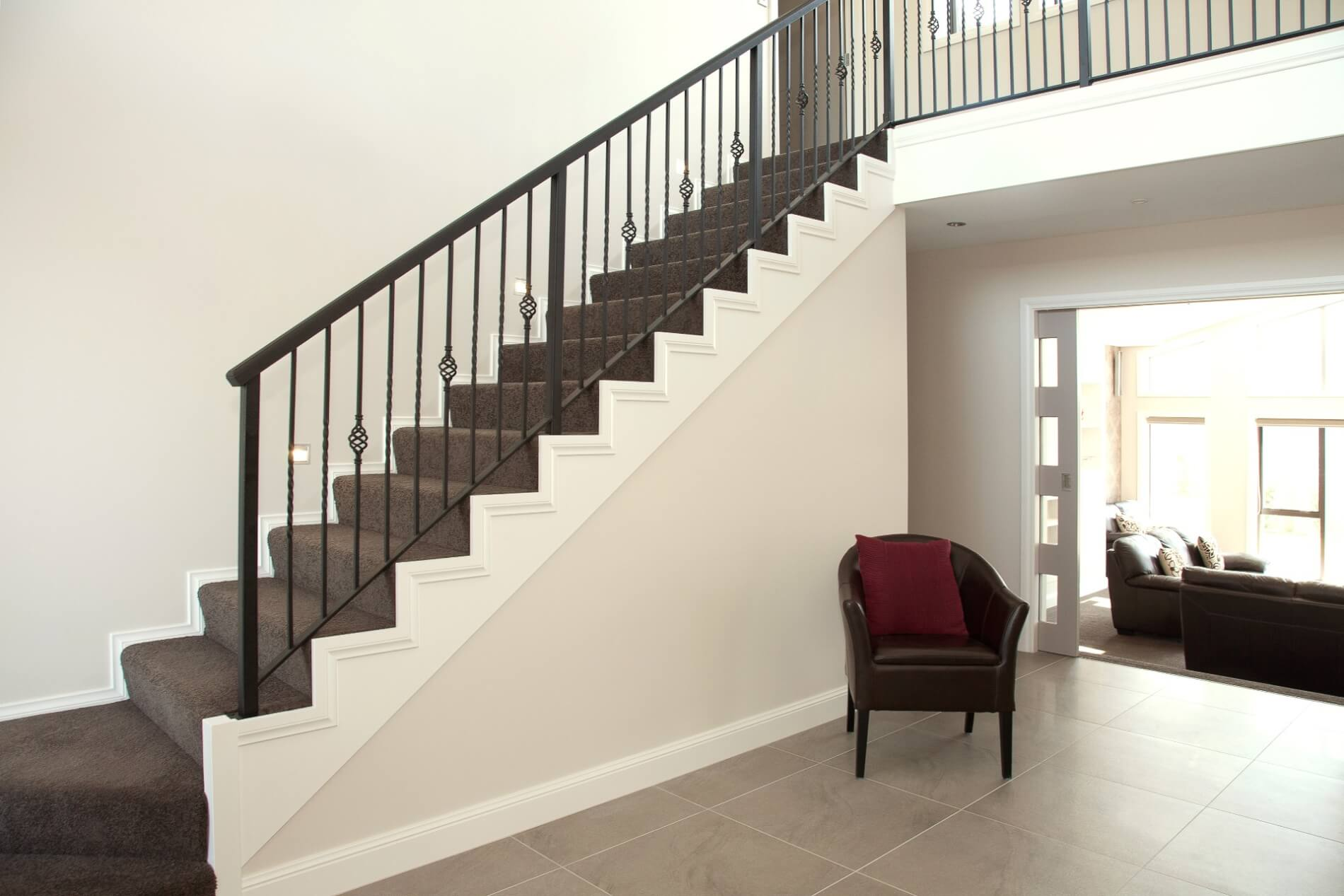 Traditional stair and wrought iron balustrade by Stylecraft Stairways