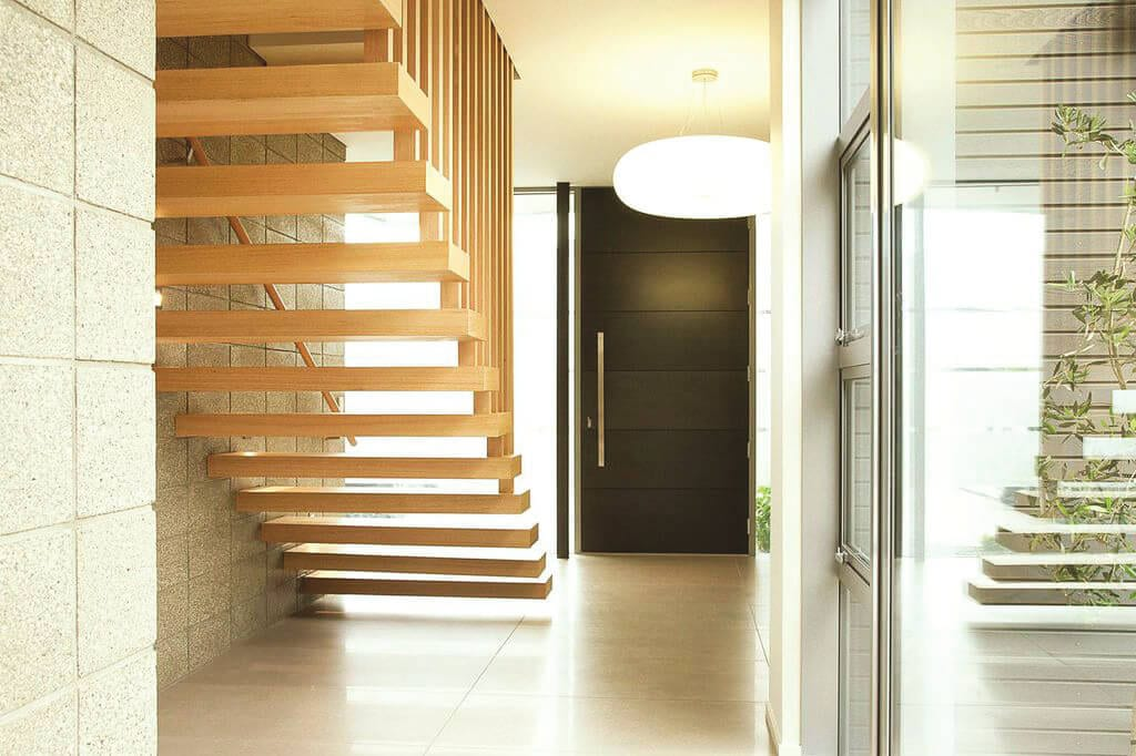 Floating steel stair and timber balustrade