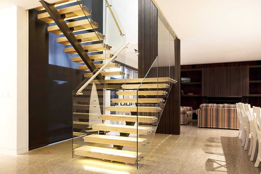Floating steel stair and glass balustrade